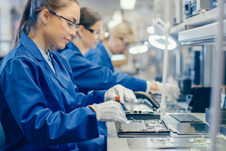 Female chip manufacturer assembling motherboard